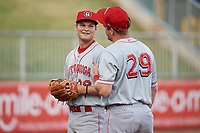 Chattanooga Lookouts Brantley Bell (28) and Mitch Nay (29) talk with young fans during warmups before a Southern League game against the Birmingham Barons on May 2, 2019 at Regions Field in Birmingham, Alabama.  Birmingham defeated Chattanooga 4-2.  (Mike Janes/Four Seam Images)