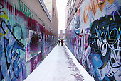 Long graffiti painted lane in winter