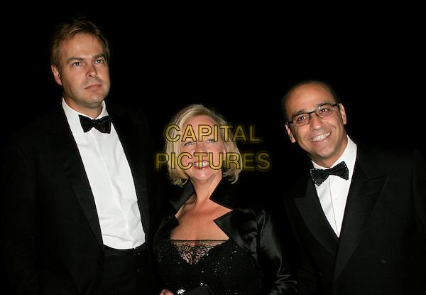 PETER JONES, DEBORAH MEADEN & THEO PAPHITIS of Dragon's Den.The British Academy Television Awards (BAFTA) afterparty at the Natural History Museum, London, England. .May 20th, 2007.half length tuxedo glasses bow tie debra .CAP/AH.©Adam Houghton/Capital Pictures