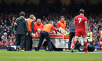Pictured: Lee Samson of Wales is taken away by paramedics after getting injured Saturday 14 March 2015<br />
