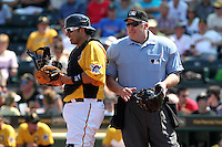 Pittsburgh Pirates catcher Rod Barajas #26 and umpire Bill Welke during a spring training game against the Minnesota Twins at McKechnie Field on March 10, 2012 in Bradenton, Florida.  Minnesota defeated Pittsburgh 4-2.  (Mike Janes/Four Seam Images)