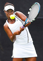 Florida International University junior Nikkita Fountain returns a shot during her match with Iowa's Krissy Dowlin in the first round of the 2006 NCAA Coral Gables Regionals at the Neil Schiff Tennis Center on Friday, May 12, 2006.  Earlier in the day, Fountain combined with doubles partner, junior Paula Zabala, to defeat Iowa's Megan Racette and Jacqueline Lee, 8-6, to help give the FIU Golden Panthers a 1 point advantage going into the singles competition.  Fountain's straight set defeat of Dowlin, 6-3, 6-2, helped ensure the 39th ranked Golden Panthers' upset of the 31st ranked Iowa Hawkeyes and advance to the second round of the regionals.