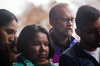 Members of CityWell Church and other community members and Rev. William Barber II meet with the family of Samuel Oliver-Bruno, at the Wake County Detention Center in Raleigh, NC Monday, November 26, 2018 to protest Samuel's arrest and hold church service. Oliver-Bruno, a Mexican immigrant living in sanctuary at CityWell since late 2017, was lured to the U.S. Citizenship and Immigration Services office in Morrisville the day after Thanksgiving for a fingerprint appoint -- part of the process to have a stay on his deportation, and ultimately become a citizen. He was subsequently arrested by ICE agents, but not after his church community blocked his detention van from leaving the parking lot. (Justin Cook)