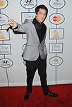 Austin Mahone arriving at the Clive Davis 2014 Pre-Grammy Gala, held at The Beverly Hilton Hotel on January 25, 2014.