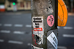 A sticker from Die Linke, Germany's left-wing political party, stuck to a pillar in Berlin Germany, welcoming refugees and opposing Nazi politics. During 2015, Germany received around one million refugees fleeing conflict in the Middle East and parts of Africa. There were over 90 refugee help centres in the city by the end of that year.
