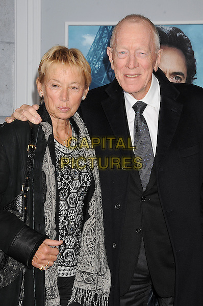 Catherine Brelet & Max von Sydow.The World Premiere of 'Sherlock Holmes: A Game of Shadows' held at The Village Theatre in Brentwood, California, USA..December 6th, 2011.half length print dress married husband wife black white tie .CAP/ROT/TM.©Tony Michaels/Roth Stock/Capital Pictures
