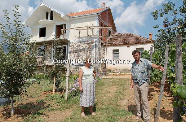 Gorica e Vogel-Korca/Korce-Albania - August 04, 2004---Construction of a new house, next to the old one, in the village of Gorica e Vogel at Lake Prespa (border lake in the triangle of Albania, Macedonia, Greece), the owners looking at their fruit orchard; project area of GTZ-Wiram-Albania (German Technical Cooperation, Deutsche Gesellschaft fuer Technische Zusammenarbeit (GTZ) GmbH); infrastructure-economy-people---Photo: © HorstWagner.eu