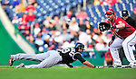 22 April 2010: Colorado Rockies' left fielder Ryan Spilborghs dives safely back to first during a game against the Washington Nationals at Nationals Park in Washington, DC. The Rockies shut out the Nationals 2-0 gaining a 2-2 series split. Mandatory Credit: Ed Wolfstein Photo