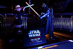 A member of the press poses with a life size statue of Darth Vader during a press tour of the exhibition Star Wars Vision at the Tokyo City View Sky Gallery in Roppongi Hills on April 28, 2015, Tokyo, Japan. The exhibition is divided into six themed areas (Original, Force, Battle, Saga, Galaxy and Droid) located in different halls, and visitors can see models of the battle spaceships, life-size statues of the principal characters and Jedi weapons from the movies. The exhibition also introduces 60 art pieces and 100 movie props. It will open to the public from April 29th to June 28th. (Photo by Lucasfilm/Rodrigo Reyes Marin/AFLO)