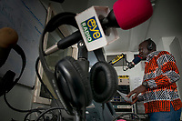 CLEMENT WANI, AKA, DJ LOMISAK,  talks about upcoming new music during his show  on Eye Radio in Juba, South Sudan.  In an effort to build up media and encourage a free media, USAID funded the station which is run by Internews.