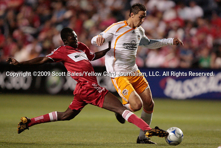05 June 2009: Chicago's Patrick Nyarko knocks the ball away from Houston's Geoff Cameron (right). The Houston Dynamo defeated the Chicago Fire 1-0 at Toyota Park in Bridgeview, Illinois in a regular season Major League Soccer game.