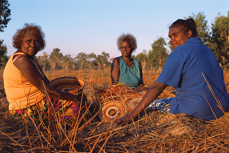Mavis Ngallametta, Hersey Yunkaporta, and Patricia Woolla, weaving baskets, Aurukun, Cape York Peninsula.