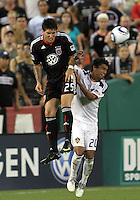 Santino Quaranta #25 of D.C. United wins a header from A.J. DeLaGarza #20 of the Los Angeles Galaxy during an MLS match at RFK Stadium on July 18 2010, in Washington D.C. Galaxy won 2-1.