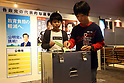 Children cast votes at children's theme park Kidzania in Tokyo