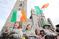 17/3/2011. ST PATRICKS DAY DUBLIN. Revellers are pictured at St Patricks Cathedral enjoying the Dublin St Patricks Day Parade. Picture James Horan/Collins Photos