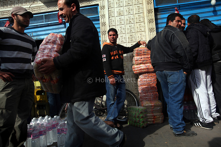 People wait in line for food at a store in Carthage suburb, Tunis, Tunisia, Jan. 16, 2011. The store would only be open until 2 p.m., when everything on the streets would close.