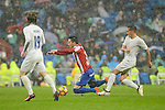 Real Madrid's player Luka Modric and Lucas Vazquez and Sporting de Gijon's player Ismael López during match of La Liga between Real Madrid and Sporting de Gijon at Santiago Bernabeu Stadium in Madrid, Spain. November 26, 2016. (ALTERPHOTOS/BorjaB.Hojas)