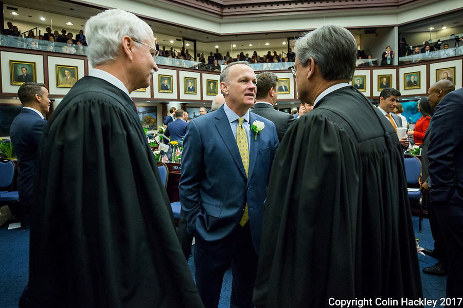 TALLAHASSEE, FLA. 3/7/17-House Speaker Richard Corcoran, R-Land O'Lakes, center, talks with Florida Supreme Court Justice Ricky Polston, left, and Chief Justice Jorge Labarga, right, during a lull in opening day ceremonies at the Capitol in Tallahassee.<br /> <br /> COLIN HACKLEY PHOTO