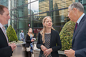 Hamish Watson, Sian Berry, Green candidate for Mayor of London, Sir George Iacobescu.  Launch of Polysolar photovoltaic bus shelter, Canary Wharf, London.