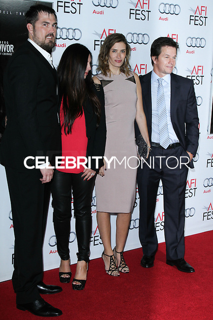 "HOLLYWOOD, CA - NOVEMBER 12: Marcus Luttrell, Melanie Juneau, Rhea Durham, Mark Wahlberg at the AFI FEST 2013 - ""Lone Survivor"" Premiere held at TCL Chinese Theatre on November 12, 2013 in Hollywood, California. (Photo by David Acosta/Celebrity Monitor)"