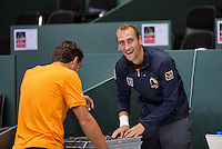 Switserland, Genève, September 16, 2015, Tennis,   Davis Cup, Switserland-Netherlands, Practise Dutch team, good atmosphere in the Dutch team Thiemo de Bakker as DJ making loud music in the tennishal<br /> Photo: Tennisimages/Henk Koster