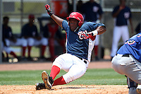 GCL Nationals Estarlin Martinez #7 slides safely into home during a game against the GCL Mets at the Washington Nationals Minor League Complex on June 20, 2011 in Melbourne, Florida.  The Nationals defeated the Mets 5-3.  (Mike Janes/Four Seam Images)