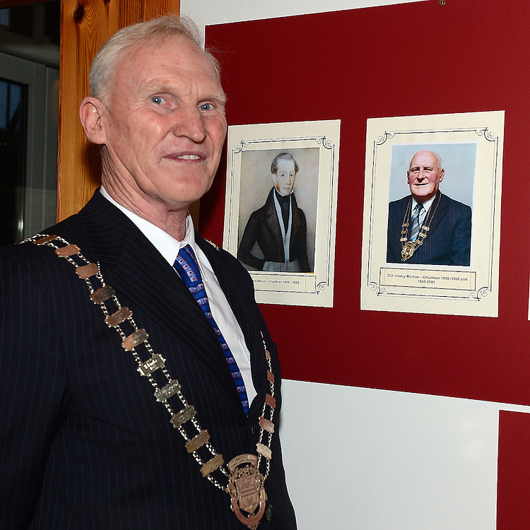 Chairperson Fintan Malone with photo of the first Chairperson Jimmy Maloneat the Ardee Town Council reunion for past members held in Ardee Castle. Photo:Colin Bell/pressphotos.ie