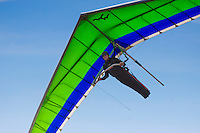 Close-up of a man hang gliding over O'ahu.