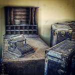 Office with old vintage typewritier and cases