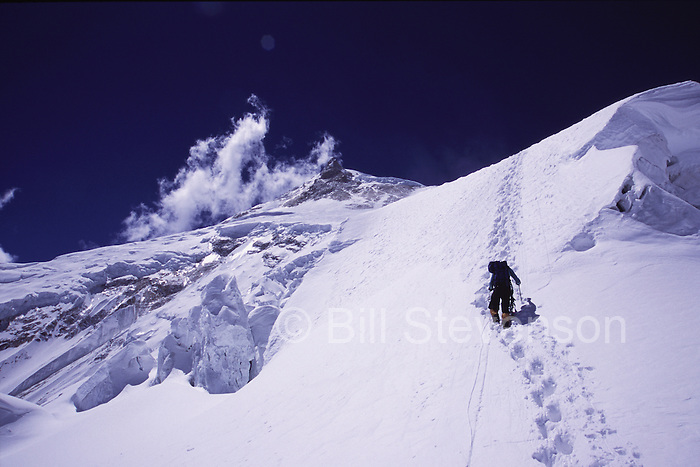 A man climbing to camp 2 on Manaslu in Nepal.