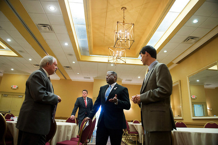 UNITED STATES - AUGUST 23:  Rep. Allen West, R-Fla., of Florida's 18th District, talks with Jamie Leach, left, and other attendees of a meeting of the Independent Insurance Agents of Palm Beach County, in West Palm Beach, Fla.  West is running against democrat Patrick Murphy.  (Photo By Tom Williams/CQ Roll Call)