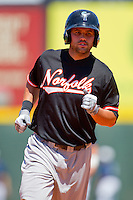 Rhyne Hughes #9 of the Norfolk Tides rounds the bases after hitting a home run against the Charlotte Knights at Knights Stadium July 5, 2010, in Fort Mill, South Carolina.  Photo by Brian Westerholt / Four Seam Images