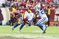 Landover, MD - September 16, 2018: Washington Redskins running back Chris Thompson (25) gets tackled during the  game between Indianapolis Colts and Washington Redskins at FedEx Field in Landover, MD.   (Photo by Elliott Brown/Media Images International)