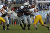 01 October 2005:  Penn State RB Tony Hunt (26) runs behind a block by tackle Levi Brown (67).  Penn State Nittany Lions  defeated the Minnesota Golden Gophers  44-14 September 1, 2005 at Beaver Stadium in State College, PA..