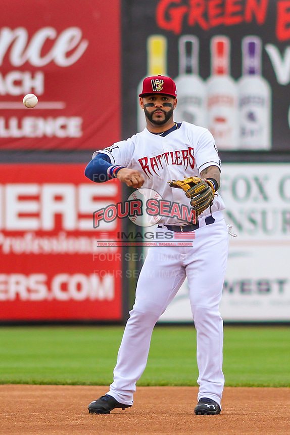 Milwaukee Brewers second baseman Jonathan Villar (3) throws to first between innings during a rehab appearance with the Wisconsin Timber Rattlers in game one of a Midwest League doubleheader against the Kane County Cougars on June 23, 2017 at Fox Cities Stadium in Appleton, Wisconsin.  Kane County defeated Wisconsin 4-3. (Brad Krause/Four Seam Images)