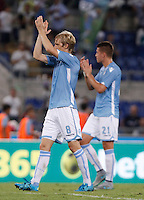 Calcio, Serie A: Lazio vs Bologna. Roma, stadio Olimpico, 22 agosto 2015.<br /> Lazio&rsquo;s Dusan Basta, left, and Sergej Milinkovic-Savic greet fans at the end of the Italian Serie A football match between Lazio and Bologna at Rome's Olympic stadium, 22 August 2015. Lazio won 2-1.<br /> UPDATE IMAGES PRESS/Isabella Bonotto