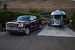 GMC Sierra pickup truck and Airstream travel trailer in camp on the California Coast