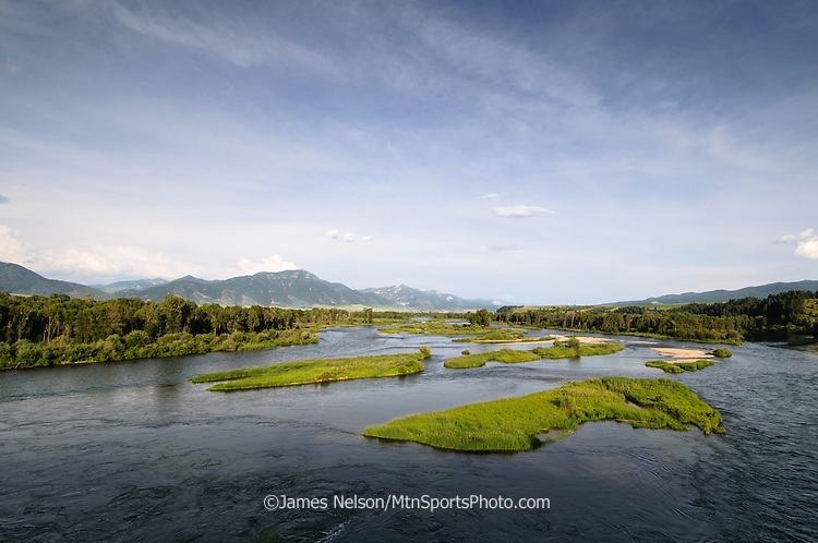 Upper South Fork of the Snake River flowing through Swan Valley in east Idaho during an summer evening,