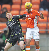 Blackpool's Clark Robertson in action with Bristol Rovers' Rory Gaffney<br /> <br /> Photographer Mick Walker/CameraSport<br /> <br /> The EFL Sky Bet League One - Blackpool v Bristol Rovers - Saturday 13th January 2018 - Bloomfield Road - Blackpool<br /> <br /> World Copyright &copy; 2018 CameraSport. All rights reserved. 43 Linden Ave. Countesthorpe. Leicester. England. LE8 5PG - Tel: +44 (0) 116 277 4147 - admin@camerasport.com - www.camerasport.com