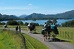 A jaunting car passes by Lough Lein in Killarney during the summer of 2010..Picture by Don MacMonagle