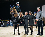 Oi Man Leung of Hong Kong riding Bamako MAurea celebrates winning with equestrian Ludger Beerbaum and Hong Kong Equestrian Federation President Michael Lee at the JETS Challenge during the Longines Masters of Hong Kong at AsiaWorld-Expo on 10 February 2018, in Hong Kong, Hong Kong. Photo by Diego Gonzalez / Power Sport Images