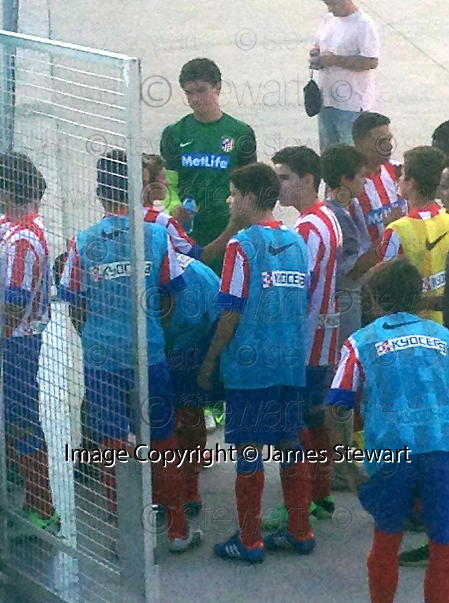 "Collect pic of Josuha Rae, who is 6' 1"" despite only being 12 years old (green top), before he plays one of his games during his trial with Atletico de Madrid.."