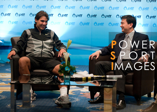 BANGKOK, THAILAND - SEPTEMBER 30:  Thailand's Prime Minister Abhisit Vejjajiva and Rafael Nadal of Spain laughs on a meeting during the PTT Thailand Open at Impact Arena on September 30, 2010 in Bangkok, Thailand. Photo by Victor Fraile / The Power of Sport Images