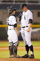 Catcher Chase Blackwood #26 of the Bristol White Sox has a chat with releif pitcher Kevin Rath #51 at Boyce Cox Field August 27, 2010, in Bristol, Tennessee.  Photo by Brian Westerholt / Four Seam Images