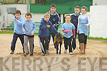 Pictured practicing for a race between a greyhound and a runner from St Brendans athlethic club during their fundraising night at Kingdom Greyhound stadium, From left Niall Marley, Conn Marley, Darragh Lowth,  Aidan Nolan, Cona?gh Fitzgerald, Shane Lowth, Grainne Raggett, and the greyhound is Bearhaven Sal.