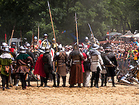 The Battle of the Knights on Vitkov Hill in Prague, showing participants in medieval dresses during a battle.