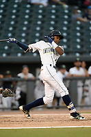 Shortstop Hansel Moreno (12) of the Columbia Fireflies bats during a game against the Charleston RiverDogs on Wednesday, August 29, 2018, at Spirit Communications Park in Columbia, South Carolina. Charleston won, 6-1. (Tom Priddy/Four Seam Images)