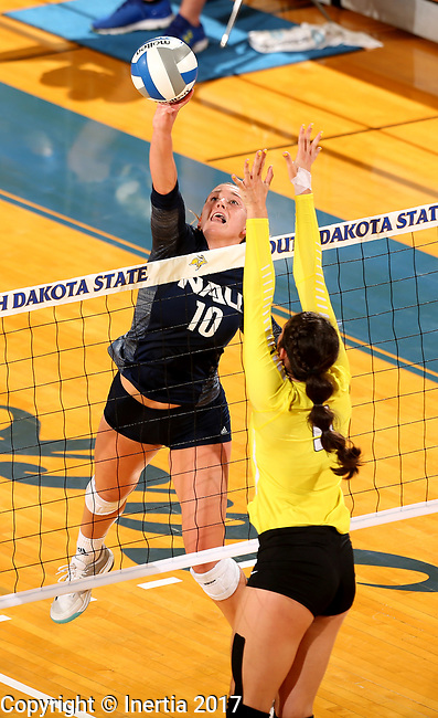 BROOKINGS, SD - SEPTEMBER 1: Sydney Lema #10 from Northern Arizona looks to get a kill past Brittany Anderson #9 from Valparaiso during their match Friday afternoon at the Jackrabbit Invitational at Frost Arena in Brookings. (Photo by Dave Eggen/Inertia)