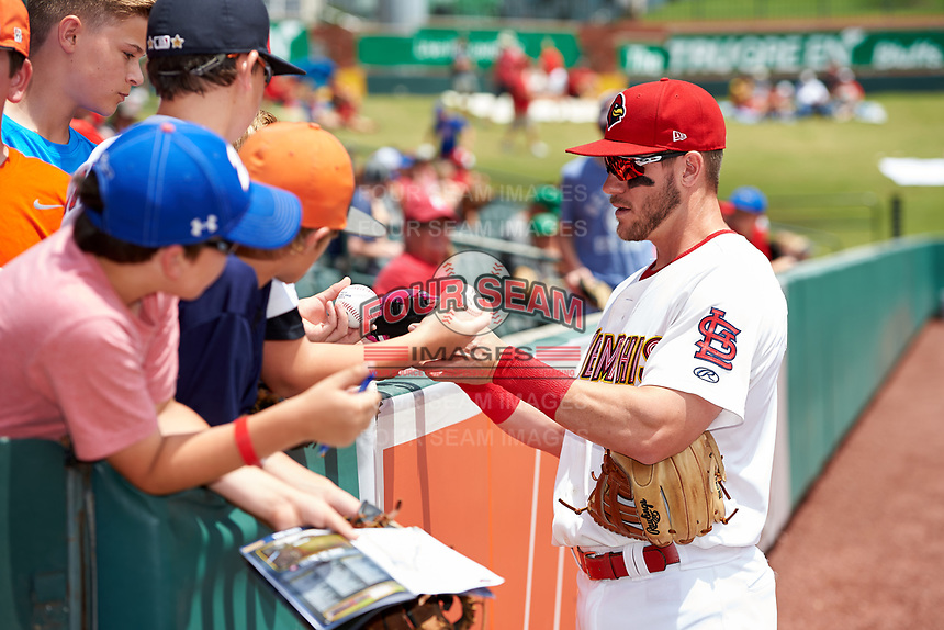 Memphis Redbirds third baseman Patrick Wisdom (5) signs autographs for fans before a game against the Iowa Cubs on May 29, 2017 at AutoZone Park in Memphis, Tennessee.  Memphis defeated Iowa 6-5.  (Mike Janes/Four Seam Images)