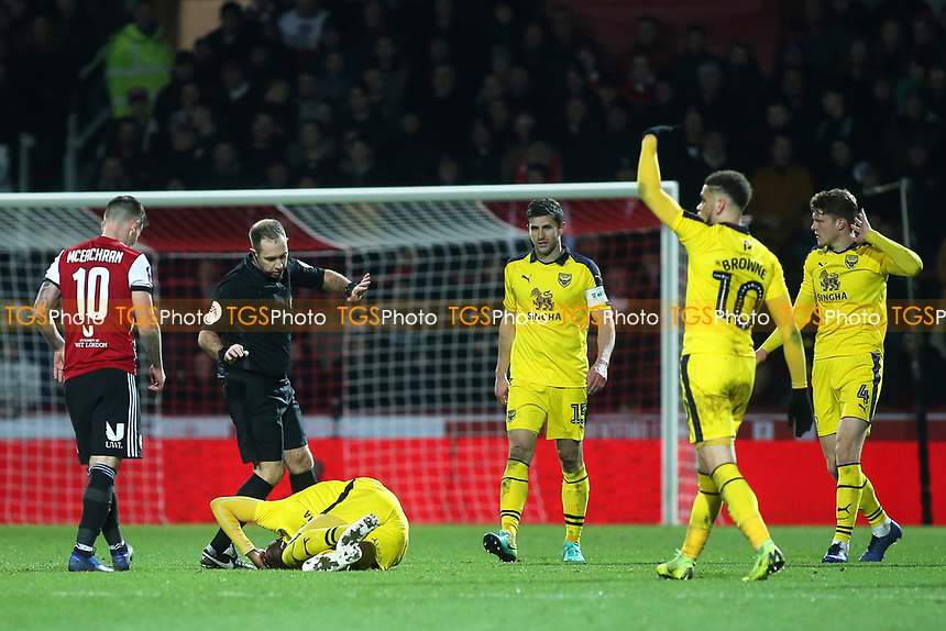 Shandon Baptiste of Oxford United falls to the ground in agony as the referee and Oxford players realise it could be a serious injury. A few minutes later he was carried off on a stretcher during Brentford vs Oxford United, Emirates FA Cup Football at Griffin Park on 5th January 2019